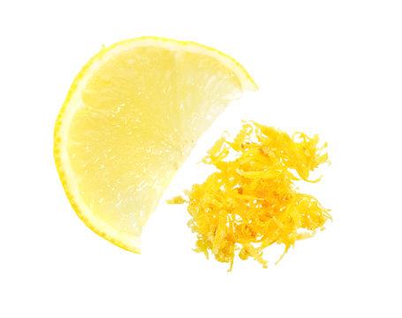 Fresh Lemon Zest with piece of fruit. Isolated on white background