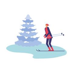 man with ski and pine tree winter season