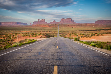 The road leading to Monument Valley, an area of giant red rock formations on the Arizona and Utah border, at sunrise