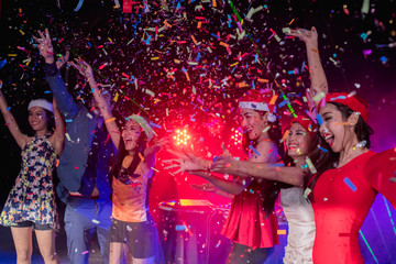 Teenagers are celebrating at the night party.