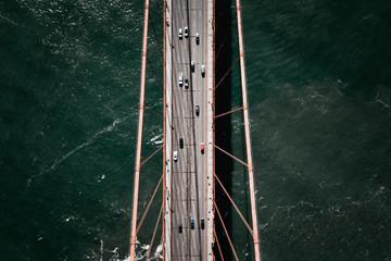 Cars on bridge over water