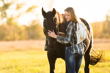 Photo sur Aluminium Equitation Girl horse rider stands near the horse and hugs the horse. Horse theme