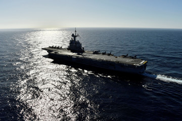"""A picture taken off Toulon shows the aircraft carrier """"Charles de Gaulle"""", after the completion of its 18 month-long renovation"""