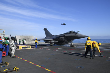 "A picture taken off Toulon shows a Rafale fighter jet taking off on the aircraft carrier ""Charles de Gaulle"", after the completion of its 18 month-long renovation"