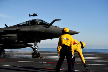 """A French fighter jet Rafale prepares to take off on the aircraft carrier """"Charles de Gaulle"""", after the completion of its 18 month-long renovation in Toulon"""