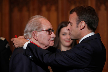 French President Emmanuel Macron awards Leon Fatous, former mayor of Arras, with the Legion of Honnour at a ceremony at the city hall in Arras