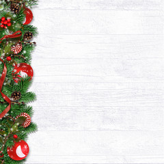Christmas border with fir branches, balls, holly and cones оn white
