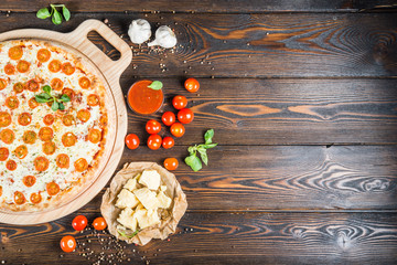 Food background design. Red sauce, cheese and cherry tomatoes. Pizza ingredients.