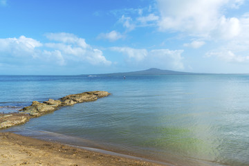 Boulder Rock and Landscape Scenery of Kohimarama Beach Auckland New Zealand; Calm Sea during Morning Time; View to Rangitoto Island Across Auckland Harbour