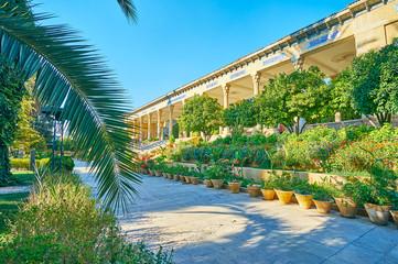 Mussala Gardens' entrance through the palm branch, Shiraz, Iran