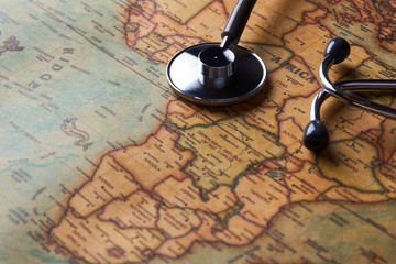 Medical stethoscope over Africa healthcheck. close-up map