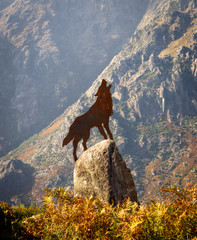 Wolf Howling Brass Figure on Top of Rock
