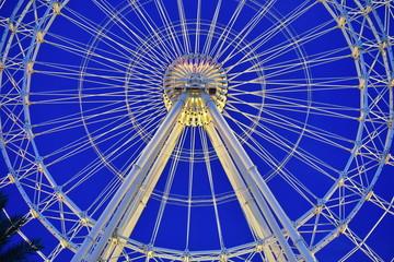 Orlando, Florida. October 18, 2018 Yellow Iluminated Big Wheel on blue sky sunset background in International Drive area.