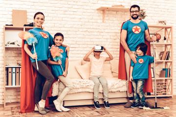 Superheroes Family Looking Kid Playing VR Headset
