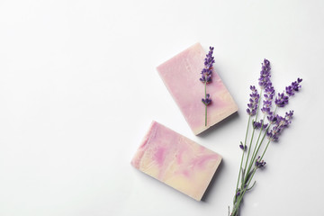 Handmade soap bars and lavender on white background, top view