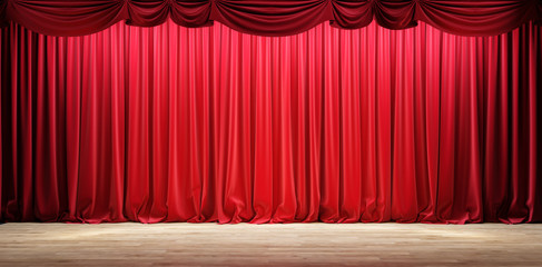 Empty theater stage with red velvet curtains.