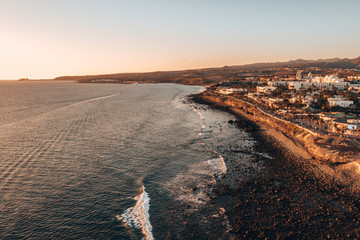 Aerial view of the Gran Canaria island during sunset. Beautiful beach near Maspalomas dunes and Meloneras district.