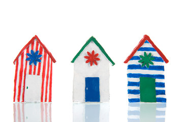 Colorful handmade beach cabins
