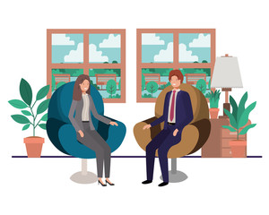business couple sitting in livingroom