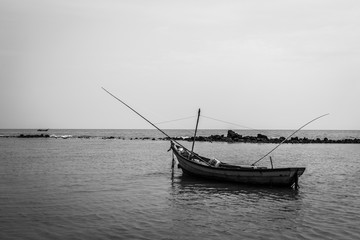 Black and white of Fishing boat on the beach