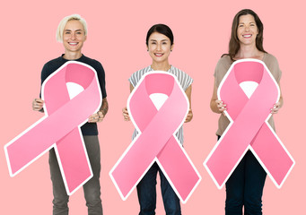 Women holding breast cancer awareness ribbons