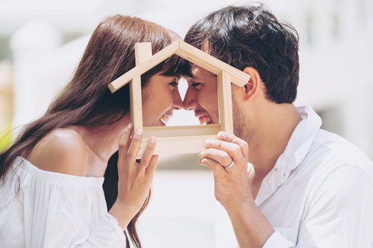 Young couple planning to buy a house and have happy living.