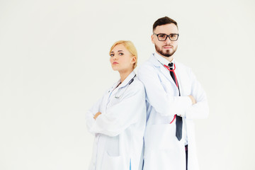 Confident doctors standing on white background with arms crossed. Concept of professional medical healthcare team.