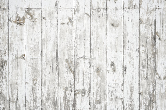 Faded white dirty weathered wood surface with long boards lined up. Wooden planks on a wall or floor with grain and texture. Light neutral flat faded tones.