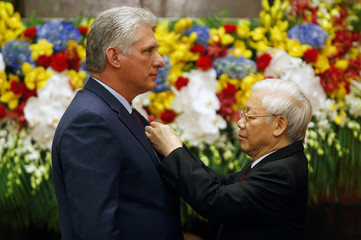 Vietnam's President Nguyen Phu Trong awards Ho Chi Minh medal to Cuba's President Miguel Diaz-Canel at the Presidential Palace in Hanoi