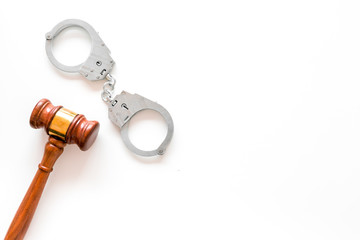Arrest concept. Metal handcuffs near judge gavel on white background top view space for text