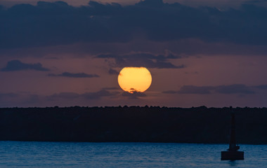 Sun Rising over the Breakwall Seascape
