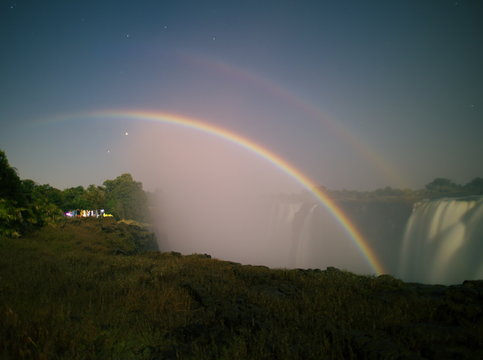 Victoria Falls,Zimbabwe-August 17, 2016: A lunar rainbow or a moonbow on the Victoria Falls observed within 2 days of full moon.