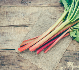 Fresh rhubarb on a wooden background/toned photo