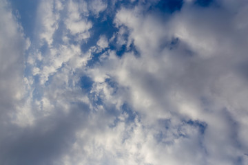 Clouds against blue sky as abstract background
