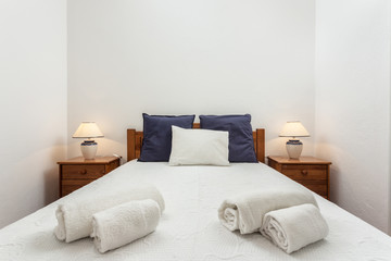 Modern bedroom with pillows and a bed for tourists. Frontally.