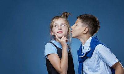 the guy kisses the girl on the cheek