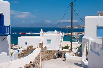 Walk path between greek rustic white houses