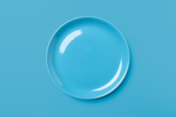 Blue pastel colored plate on blue background.