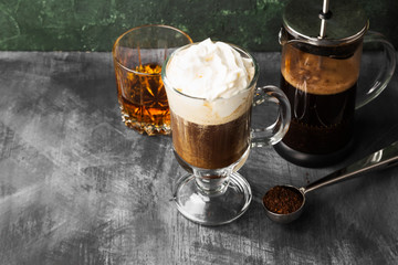 Irish coffee with whisky on dark background. Copy space. Food background