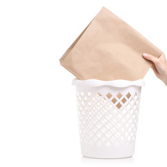 Office white bucket paper bag in hand on a white background. Isolation
