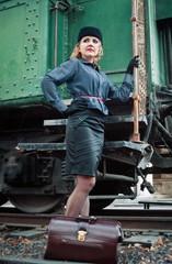 Retro woman on the train station