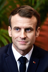 French President Emmanuel Macron meets with associations and beneficiaries regarding the government's plan to fight poverty in Lens, France