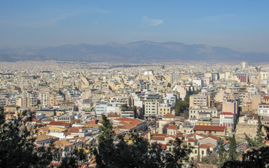 Athens from above with white buildings architecture, mountain, trees, blue sky in the morning hour in summer