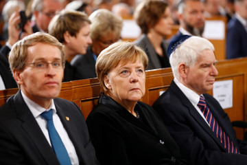 German Chancellor Angela Merkel attends a ceremony marking the 80th anniversary of Kristallnacht, also known as the Night of Broken Glass, at Rykestrasse Synagogue, in Berlin