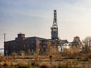 Ruins of abandoned building and crane. Post apocalyptic/nuclear fallout image.