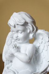 Statue of angel with folded hands praying