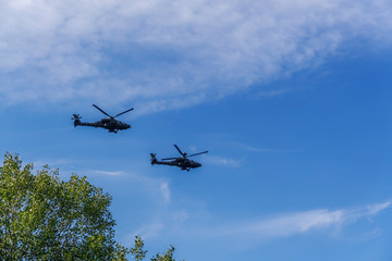 Greek Air Force Apache helicopters flying. 