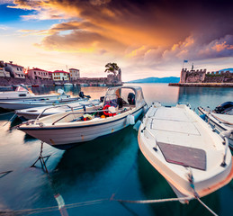 Colorful spring view of the Nafpaktos port. Fantastic sunrise in the Gulf of Corinth, Greece, Europe. Beauty of countryside concept background.