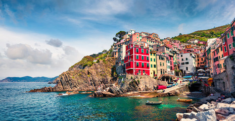 Ligurie First city of the Cique Terre sequence of hill cities - Riomaggiore. Colorful morning view of Liguria, Italy, Europe. Great spring seascape of Mediterranean sea. Traveling concept background.