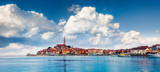 Picturesque spring cityscape of Rovinj town, Croatian fishing port on the west coast of the Istrian peninsula. Colorful morning seascape of Adriatic Sea. Traveling concept background.